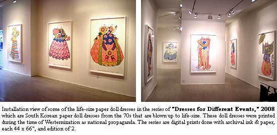 Installation view of some of the life-size paper doll dresses in the series of